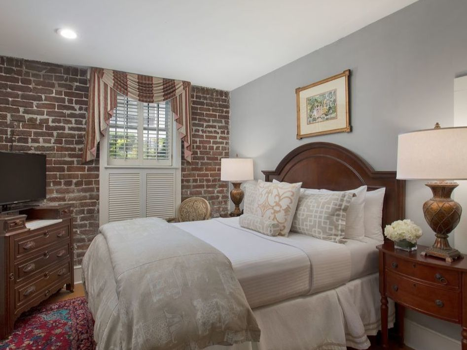 Guest room with brick accent wall